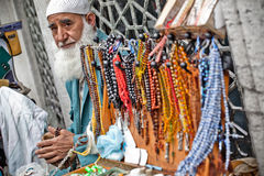 Muslim man sells mala beads Royalty Free Stock Images
