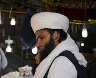 Muslim Man. A Muslim man shopping at Data-Darbar Lahore, Pakistan Stock Photo