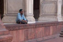 Muslim man sitting at Jama Masjid in Delhi, India Royalty Free Stock Photography