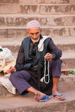 Muslim man sitting on the stairs of Jama Masjid in Delhi, India Royalty Free Stock Image