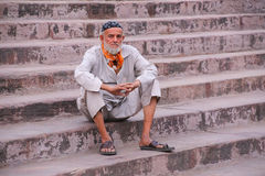 Muslim man sitting on the stairs of Jama Masjid in Delhi, India Stock Image