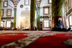 Muslim man sleeping in a mosque in Trabzon stock image
