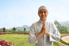 Muslim man smiling. And greeting Stock Images