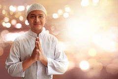 Muslim man smiling. And greeting Royalty Free Stock Image