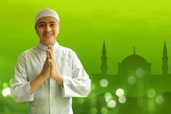 Muslim man smiling. And greeting Stock Photo