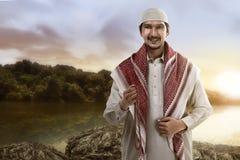 Muslim man smiling holding prayer beads Stock Photography