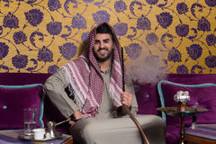 Muslim Man Smoking The Traditional Hookah Royalty Free Stock Images