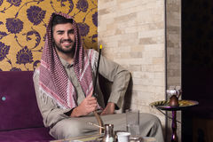 Muslim Man Smoking The Traditional Hookah Stock Images