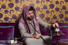 Muslim Man Smoking The Traditional Hookah Stock Photo