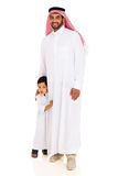 Muslim man standing son Royalty Free Stock Image