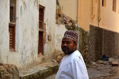 Muslim man, Stone Town, Zanzibar. Muslim man in the old streets of Stone Town, Zanzibar, Tanzania stock images