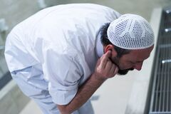 Muslim man taking ablution for prayer. Islamic Religious Rite Ceremony Of Ablution. Young Muslim man perform ablution wudhu