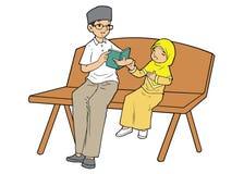 Muslim man teaching koran. Indonesian muslim man teaching koran to a young girl Stock Image