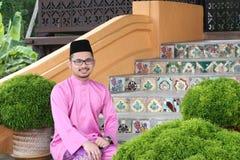 A muslim man with traditional baju melayu Stock Images