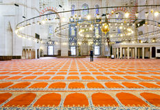 Muslim man walking on the carpet inside the famous Suleymaniye Mosque Royalty Free Stock Photography
