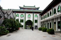 Muslim man walks in entrance courtyard of mosque Beijing China. Beijing, China - October 20, 2015: A lone Muslim man walks in the courtyard of a Chinese Islamic Royalty Free Stock Photo
