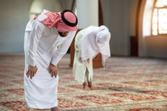Muslim man and woman praying in mosque Stock Photography