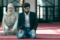 Muslim man and woman praying in mosque Royalty Free Stock Photography
