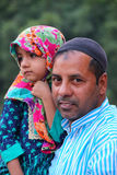 Muslim man with young girl standing outside of Jama Masjid in De Stock Photography