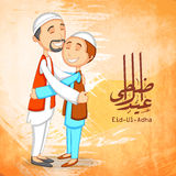 Muslim men and Arabic calligraphy for Eid-Ul-Adha. Happy Muslim men hugging each other and Arabic Islamic calligraphy of text Eid-Ul-Adha on orange color splash Stock Photography