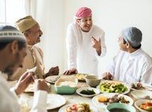 Muslim men celebrating ending of Ramadan royalty free stock image