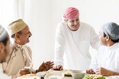 Muslim men celebrating ending of Ramadan royalty free stock photo