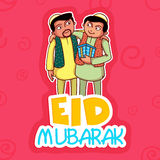 Muslim men with gift for Eid festival celebration. Young religious Muslim men wishing and giving gifts to each other on occasion of Islamic holy festival, Eid Royalty Free Stock Images