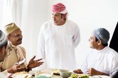 Muslim men having a meal stock images
