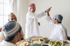 Muslim men making a high five royalty free stock photos