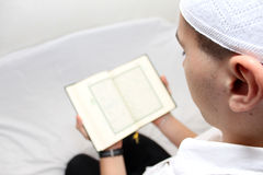 Muslim men Reading Holy Islamic Book Koran Stock Images