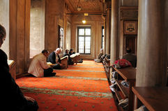 Muslim men reading the Holy Quran Stock Photo