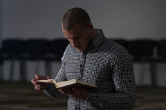 Muslim Men Is Reading The Koran Royalty Free Stock Photo