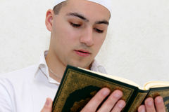 Muslim Men Reading The Koran Stock Photos