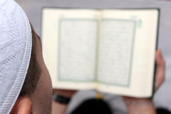 Muslim Men Reading The Koran Stock Photo