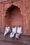 Muslim men sitting at Jama Masjid in Delhi, India Royalty Free Stock Photo