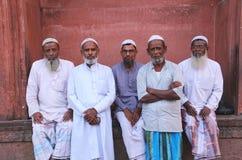 Muslim men standing at Jama Masjid in Delhi, India Stock Image