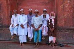 Muslim men standing at Jama Masjid in Delhi, India Royalty Free Stock Photo