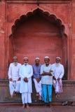 Muslim men standing at Jama Masjid in Delhi, India Stock Images