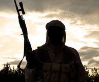 Muslim militant. Silhouette of muslim militant with rifle