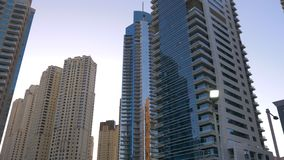 Muslim mosque and glass skyscrapers in Dubai Marina in United Arab Emirates. Muslim mosque and modern glass skyscrapers in Dubai Marina in United Arab Emirates stock footage