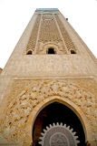 Muslim in  mosque  morocco  africa  minaret   religion and Royalty Free Stock Image