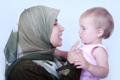 Muslim mother with a baby royalty free stock photo