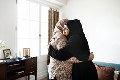 Muslim mother and daughter hugging Royalty Free Stock Photography