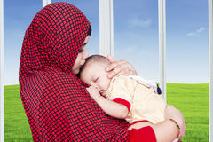 Muslim mother and her baby boy at home Royalty Free Stock Photos