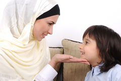 Muslim mother and her son Stock Image