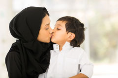 Muslim mother kissing baby Royalty Free Stock Photography