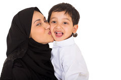 Muslim mother kissing son Royalty Free Stock Images