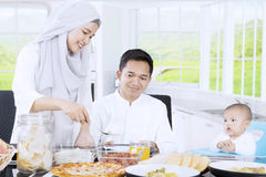 Muslim mother preparing food for family Stock Photography