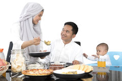 Muslim mother preparing food for family Stock Images