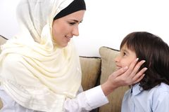 Muslim mother and son relaxing royalty free stock photography